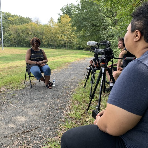 Kris Henderson of Amistad Law Project interview Yvonne Newkirk with a film crew from Bonfire Media Collective